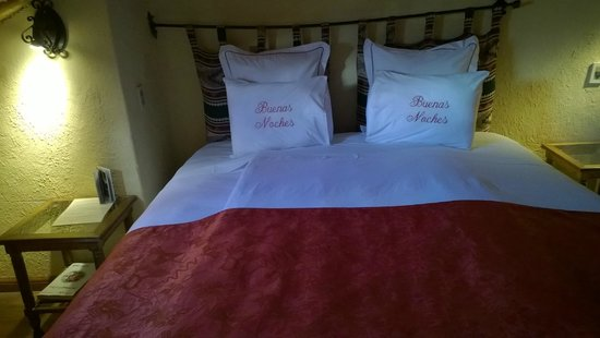 Hotel Arqueologo Exclusive Selection: Our queen-sized bed.  Our room was on 2 floors with a single bed downstairs.