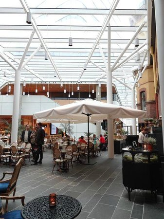 Stora Hotellet Umeå: The 'inside outside' dining/breakfast area with a glass ceiling