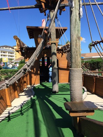 Smuggler Cove Adventure Golf: One hole is even IN the pirate ship!