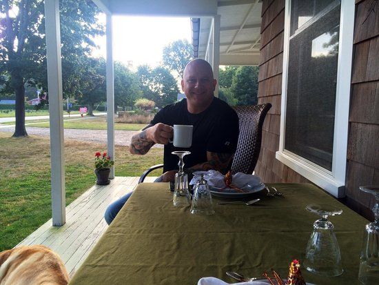 The Farmhouse Bed and Breakfast: Mike enjoys coffee on the front porch