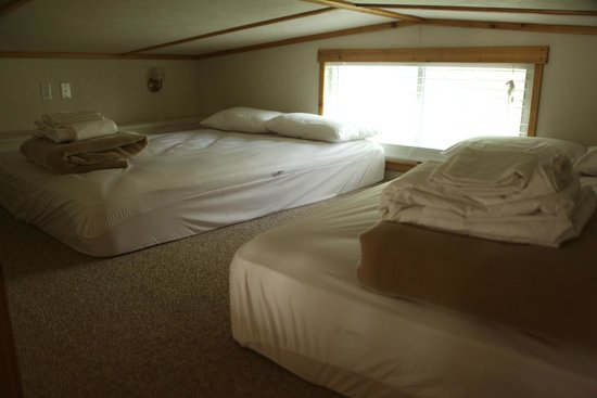 Hill Country Cottage and RV Resort: two full size beds in the loft of some cottages