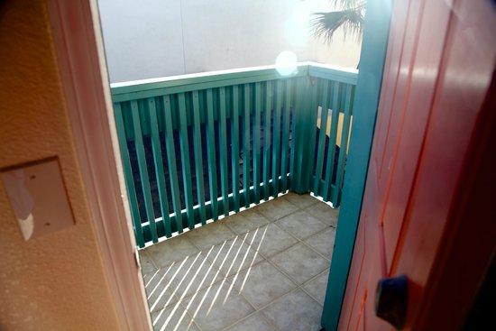 Seaside Inn: Rear balcony with railing eaten up by termites