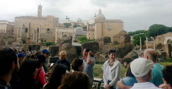 Eternal City Tours: Paul shares a laugh with a tour group on Palatine Hill ruins, Rome.