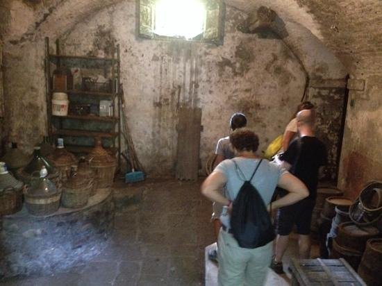 We Like Tuscany: looking in the wine cellar of the home we had lunch at