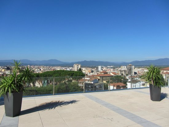 AC Hotel Palau de Bellavista: View from the large deck area down on Girona