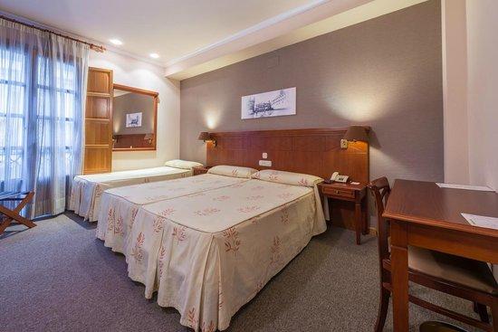 Hotel Herradura: Habitación doble con cama supletoria