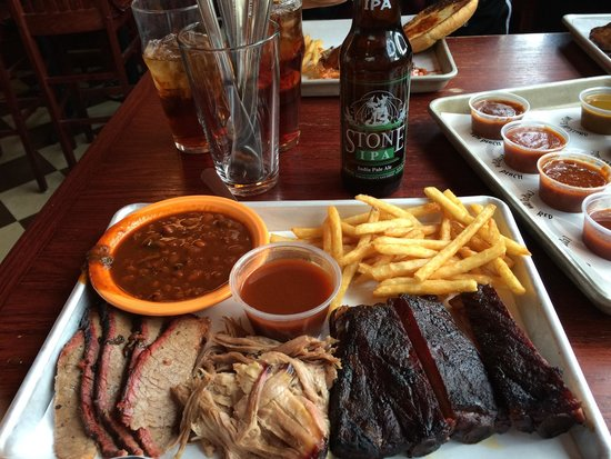 Black Dog Smoke & Ale House: Combo platter with ribs, pulled pork, and brisket. Sides are beans and fries.
