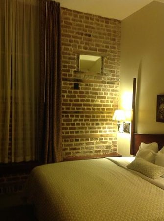 Embassy Suites by Hilton Charleston - Historic Charleston: original walls retained in the bedroom.