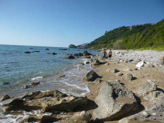 BLACK ROCKS ON AGIOS GORDIOS BEACH - Picture of Black Rocks