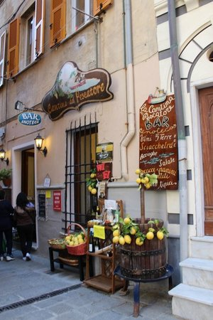 La Cantina del Pescatore : From outside, you can sit inside or across the door on opposite side of passage