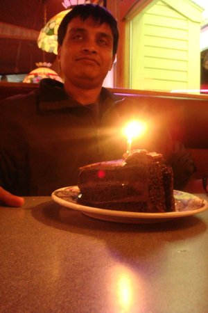 Mr.Pizza : The birthday boy with the chocolate cake