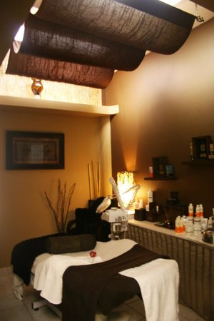 Amazing You Day Spa: Treatment room featured in magazine.