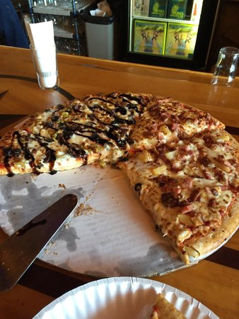 "Bellaire, MI: 16"" pizza, half w/Ham, bacon and pineapple and half w/ their feature of the day- bacon, black/gr"