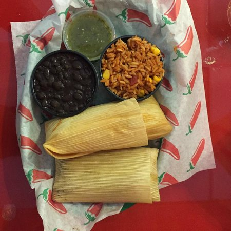 Tamales with rice and beans on the side.