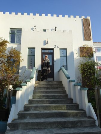 Castle House Luxury Apartments: My wife, Annie, standing at the front door.  Multiple apartments (4 I believe?) were inside.