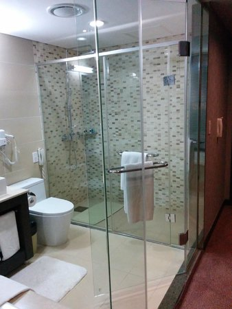 Blue Sky Hotel U0026 Tower: Bathroom Showing Glass Wall, Toilet, And Shower (