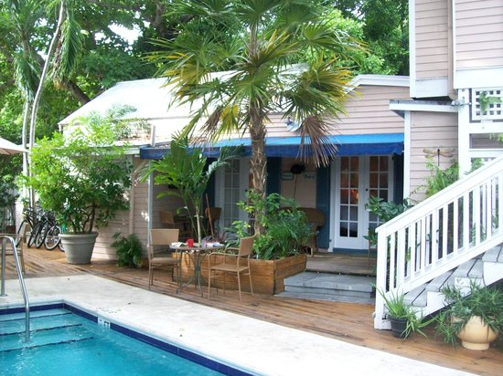 Andrews Inn and Garden Cottages: two side by side rooms and veranda just off pool