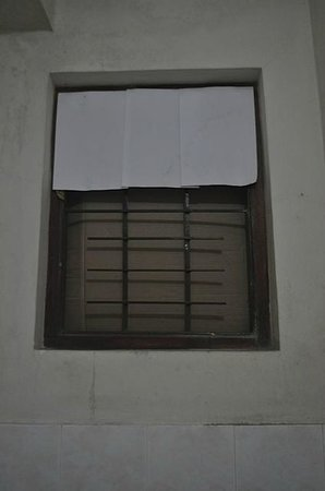 Nathashiya Holiday Inn : The boarded up window, think of mosquitos