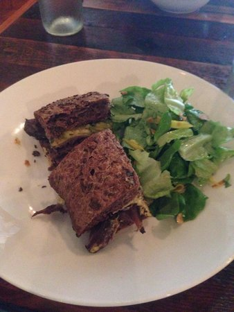 Vanessa's Pastrami Sandwich with mixed greens.