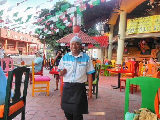 Mextreme: Our server, Christian, serving our dinks.
