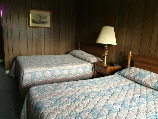 ANCHORAGE MOTEL: Wooden paneling and poor lighting made for a dark room.