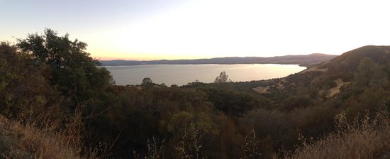 The sun beginning to set over Clear Lake from a mountain top resort