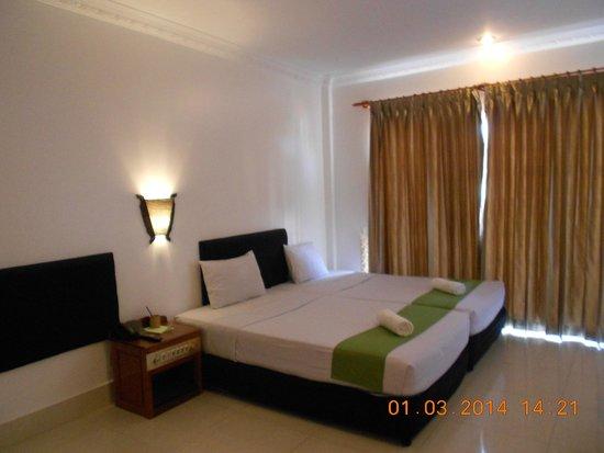 Siem Reap Evergreen Hotel: Кровать в номере