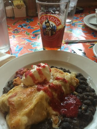 Fromage & Other Fine Foods: Chicken & chorizo enchiladas over spiced black beans w/ sour cream & berry jalapeño purée