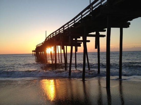The pier at sunrise picture of avon fishing pier avon for Carolina beach fishing pier