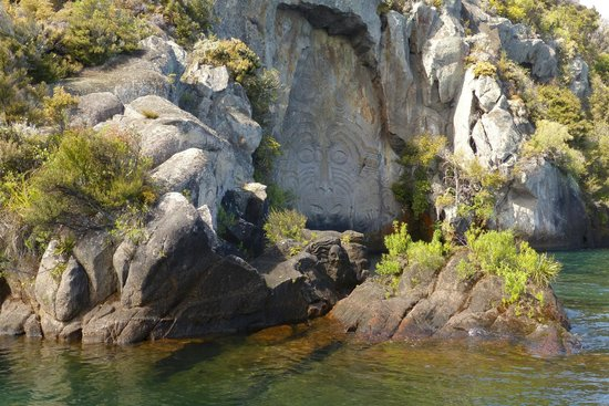 Maori rock carvings on the shore of mine bay lake taupo