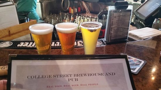 College Street Brewhouse & Pub: Flight of three beers - far right is Big Blue VA. Yes, those are blueberries floating!