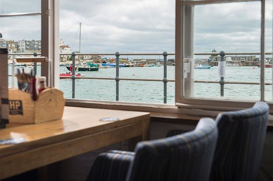 Enjoy a meal at the Lifeboat Inn with harbour sea views