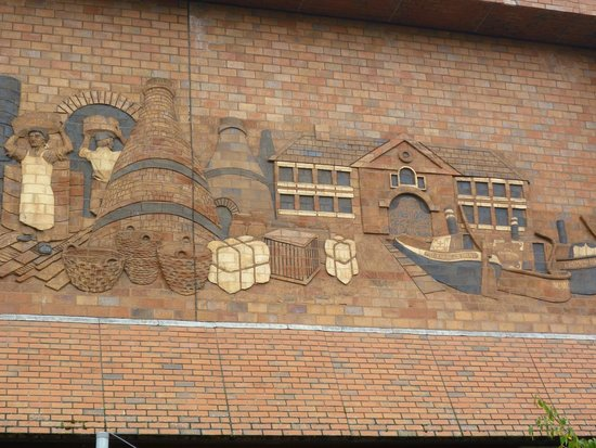 The Potteries Museum and Art Gallery: Brick bass relief  above the entrance to the museum and gallery