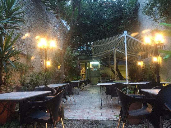 Coco Viet : The outdoor dining area, with its garden and lights