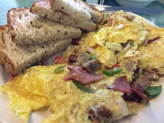 The BeachSide Cafe: Beachside Skillet Eggs, Ham, Bacon, Sausage, Onion, Green Pepper, Tomatoes & Hash Browns are Gri