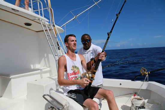 The first mahi mahi being reeled in picture of grand for Grand slam fishing