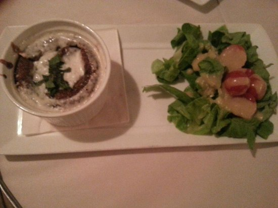 Mancini: suffle mushrooms and cheese, served on a bed of green salad