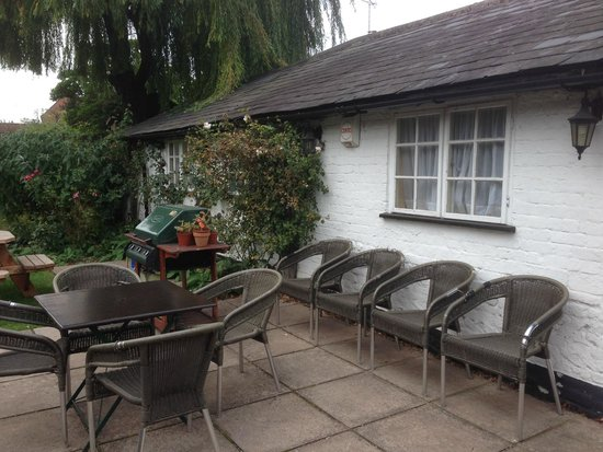 Saracen's Head Inn: Smoking table and chairs in the garden - the chairs are directly underneath a bedroom window