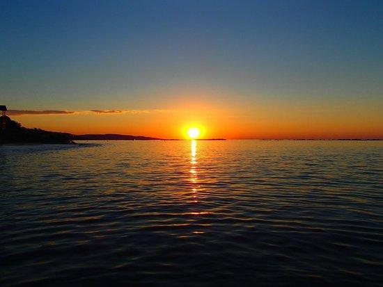 Poseidonia Beach Hotel: Sunrise during morning swim