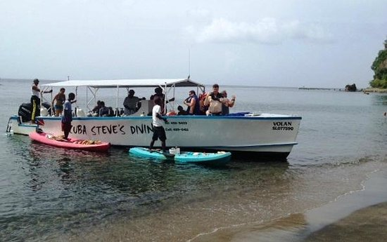 Scuba Steve's Diving Ltd.: Locals pulled up to the dive boat (beached for bathroom break) selling crafts from their canoes.