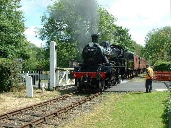 Dereham, UK: Steam train enters Wymondham Abbey