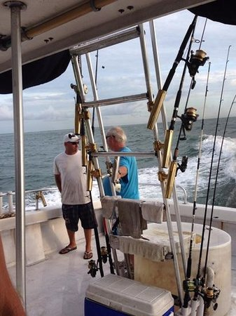 Sea Dog Fishing Charters : Chris on left getting bait and poles ready.