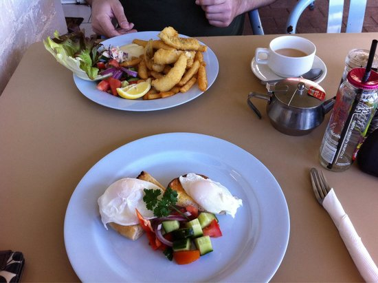Pelican Rocks Seafood Restaurant: Brekky consists of Fish and chips ($15) for him, poached egg ($10) for me