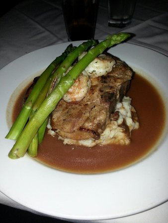 St. Andrews : Surf and terf. Shrimp and asparagus over a huge perfectly prepared pork chop over mashed!