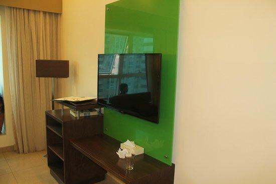 Xclusive Casa Hotel Apartment : TV in sitting area