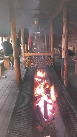 BIRK Husky Accommodation B&B & cabins: The fire pit in the long dining hall