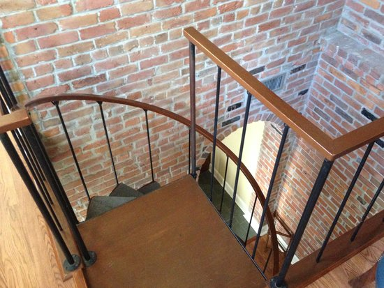 Grenoble House: Spiral Staircase Leading to First Floor of Suite