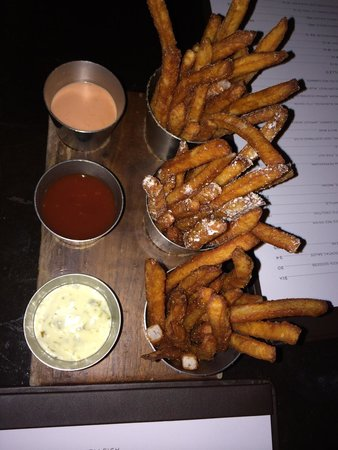 Bourbon Steak: Duck fat fries all seasoned differently with three different dipping sauces