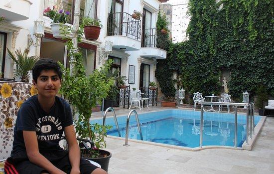 Saint John Hotel: Omeed (my son) at the pool