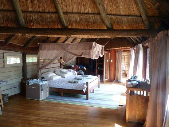 Saadani River Lodge: Interior of room from sitting area, bathroom entrance in rear